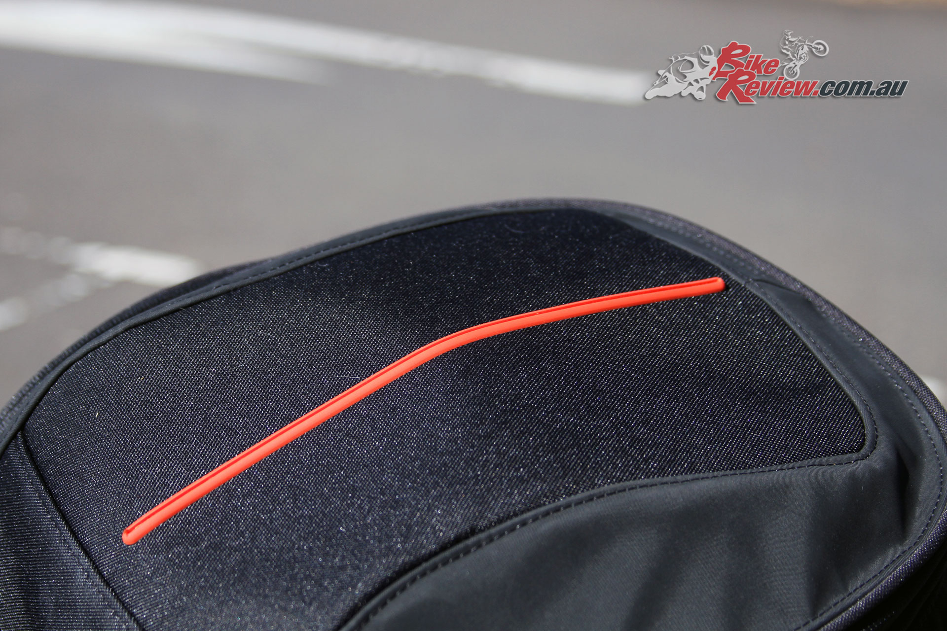 The red stripe across the top of the bike adds a touch of style, while reflective piping helps visibility