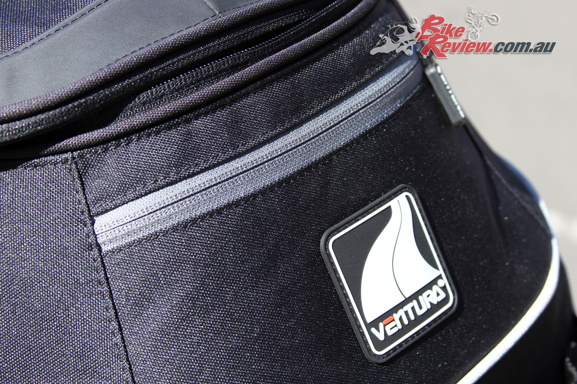 A rear pocket offers easy storage and access to small items on the EVO-22 bag
